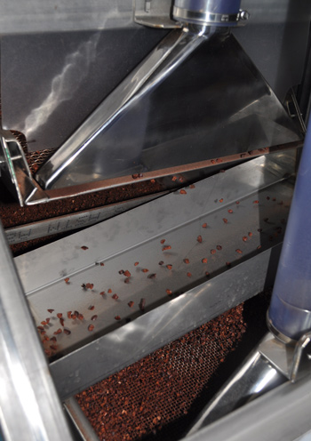 winnower cracking, separating and sifting the beans